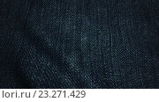 Купить «Джинсовая ткань на ветру», видеоролик № 23271429, снято 6 июля 2016 г. (c) Роман Будников / Фотобанк Лори