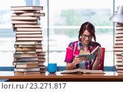 Купить «Young woman student preparing for college exams», фото № 23271817, снято 26 мая 2016 г. (c) Elnur / Фотобанк Лори
