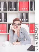 Купить «Скучающая женщина в офисе», фото № 23276641, снято 29 июня 2016 г. (c) Darkbird77 / Фотобанк Лори