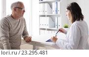 Купить «senior man and doctor meeting at hospital 46», видеоролик № 23295481, снято 15 июля 2016 г. (c) Syda Productions / Фотобанк Лори