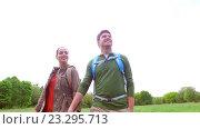 Купить «happy couple with backpacks walk on country road 1», видеоролик № 23295713, снято 18 июля 2016 г. (c) Syda Productions / Фотобанк Лори