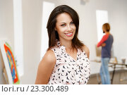 Купить «Portrait of young woman in gallery», фото № 23300489, снято 24 января 2015 г. (c) Sergey Nivens / Фотобанк Лори