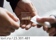 Купить «close up of addict buying dose from drug dealer», фото № 23301481, снято 9 июня 2016 г. (c) Syda Productions / Фотобанк Лори