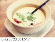 Купить «bowl of creamy soup with shrimps on table», фото № 23301517, снято 15 февраля 2015 г. (c) Syda Productions / Фотобанк Лори