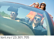 Купить «happy friends driving in cabriolet car», фото № 23301705, снято 28 мая 2016 г. (c) Syda Productions / Фотобанк Лори