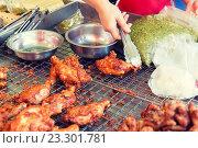 Купить «close up of cook hand with tongs grilling chicken», фото № 23301781, снято 7 февраля 2015 г. (c) Syda Productions / Фотобанк Лори