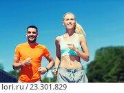 Купить «smiling couple running outdoors», фото № 23301829, снято 5 июля 2015 г. (c) Syda Productions / Фотобанк Лори
