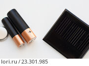 Купить «close up of alkaline batteries and solar cell», фото № 23301985, снято 3 июня 2016 г. (c) Syda Productions / Фотобанк Лори