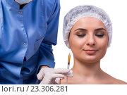 Купить «Young woman preparing for injection of botox isolated on white», фото № 23306281, снято 30 мая 2016 г. (c) Elnur / Фотобанк Лори