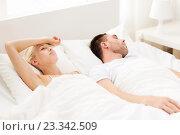 Купить «couple sleeping in bed at home», фото № 23342509, снято 6 июня 2015 г. (c) Syda Productions / Фотобанк Лори
