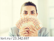 Купить «woman hiding her face behind euro money fan», фото № 23342697, снято 2 июля 2015 г. (c) Syda Productions / Фотобанк Лори