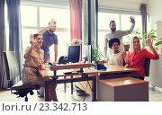 Купить «happy creative team waving hands in office», фото № 23342713, снято 29 марта 2015 г. (c) Syda Productions / Фотобанк Лори