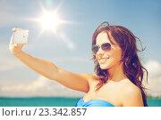 Купить «woman in bikini with phone», фото № 23342857, снято 21 июля 2012 г. (c) Syda Productions / Фотобанк Лори