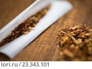 Купить «close up of marijuana or tobacco cigarette paper», фото № 23343101, снято 9 июня 2016 г. (c) Syda Productions / Фотобанк Лори