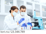 Купить «young scientists making test or research in lab», фото № 23344789, снято 4 декабря 2014 г. (c) Syda Productions / Фотобанк Лори