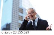 Купить «senior businessman calling on smartphone in city», видеоролик № 23355529, снято 23 июля 2016 г. (c) Syda Productions / Фотобанк Лори