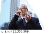 Купить «senior businessman calling on smartphone in city», видеоролик № 23355569, снято 25 июля 2016 г. (c) Syda Productions / Фотобанк Лори