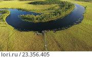 Купить «Изгиб реки Пезега в Карелии. Болотистое русло», видеоролик № 23356405, снято 21 июля 2016 г. (c) Кекяляйнен Андрей / Фотобанк Лори