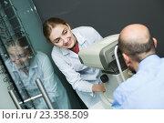 Купить «Female optician doing eye examination with aid of slit lamp», фото № 23358509, снято 20 июля 2018 г. (c) Яков Филимонов / Фотобанк Лори