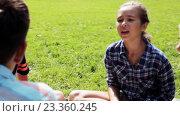 Купить «group of happy kids sitting on grass and talking», видеоролик № 23360245, снято 30 июля 2016 г. (c) Syda Productions / Фотобанк Лори