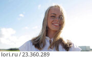 Купить «smiling young woman in white dress outdoors», видеоролик № 23360289, снято 3 августа 2016 г. (c) Syda Productions / Фотобанк Лори