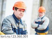 Купить «Portrait of two workers at construction site», фото № 23360301, снято 2 февраля 2016 г. (c) Дмитрий Калиновский / Фотобанк Лори