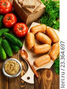 Купить «Сардельки, горчица и свежие овощи. Вид сверху», фото № 23364697, снято 3 августа 2016 г. (c) Надежда Мишкова / Фотобанк Лори