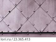 Купить «Металлические листы с заклёпками», фото № 23365413, снято 26 марта 2016 г. (c) Зезелина Марина / Фотобанк Лори
