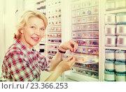 Купить «Female next to shelf with buttons», фото № 23366253, снято 23 мая 2019 г. (c) Яков Филимонов / Фотобанк Лори