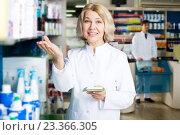 Купить «Pharmacist and pharmacy technician posing in drugstore», фото № 23366305, снято 17 октября 2018 г. (c) Яков Филимонов / Фотобанк Лори