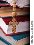 Купить «Bible and cross in religious concept», фото № 23368505, снято 24 мая 2016 г. (c) Elnur / Фотобанк Лори