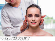 Купить «Young woman during face and skin massage session», фото № 23368817, снято 16 июня 2016 г. (c) Elnur / Фотобанк Лори
