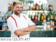 Купить «barman portrait standing near bartender desk in restaurant bar», фото № 23371417, снято 23 июня 2016 г. (c) Дмитрий Калиновский / Фотобанк Лори