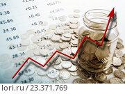 Купить «Банка монет с цифрами и диаграммой», фото № 23371769, снято 3 августа 2016 г. (c) Александр Калугин / Фотобанк Лори