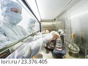 Купить «workers in protective uniform at laboratory», фото № 23376405, снято 4 июня 2015 г. (c) Дмитрий Калиновский / Фотобанк Лори