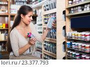 Купить «woman choosing paint in aerosol can in shop», фото № 23377793, снято 26 июня 2019 г. (c) Яков Филимонов / Фотобанк Лори