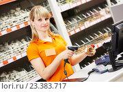Купить «Seller with barcode scanner in shop», фото № 23383717, снято 14 мая 2015 г. (c) Дмитрий Калиновский / Фотобанк Лори