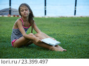 Купить «Girl are reading book at summer meadow», фото № 23399497, снято 6 августа 2016 г. (c) Кравецкий Геннадий / Фотобанк Лори