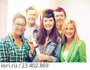 Купить «girl in graduation cap with certificate», фото № 23402869, снято 16 июня 2013 г. (c) Syda Productions / Фотобанк Лори