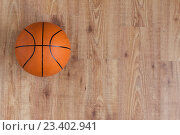 Купить «close up of basketball ball on wooden floor», фото № 23402941, снято 17 июня 2016 г. (c) Syda Productions / Фотобанк Лори
