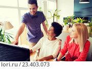 Купить «happy creative team with computer in office», фото № 23403073, снято 29 марта 2015 г. (c) Syda Productions / Фотобанк Лори