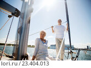 senior couple hugging on sail boat or yacht in sea. Стоковое фото, фотограф Syda Productions / Фотобанк Лори
