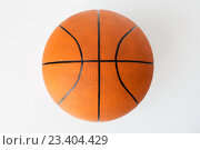 Купить «close up of basketball ball over white background», фото № 23404429, снято 17 июня 2016 г. (c) Syda Productions / Фотобанк Лори