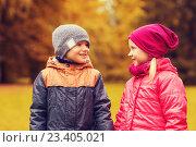 Купить «happy little girl and boy talking in autumn park», фото № 23405021, снято 10 октября 2015 г. (c) Syda Productions / Фотобанк Лори