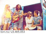 happy hippie friends playing music over minivan. Стоковое фото, фотограф Syda Productions / Фотобанк Лори