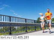 Купить «smiling couple running at summer seaside», фото № 23405281, снято 5 июля 2015 г. (c) Syda Productions / Фотобанк Лори