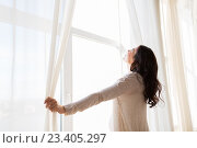 Купить «close up of pregnant woman opening window curtains», фото № 23405297, снято 23 марта 2016 г. (c) Syda Productions / Фотобанк Лори
