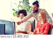 Купить «happy creative team with computer in office», фото № 23405353, снято 29 марта 2015 г. (c) Syda Productions / Фотобанк Лори