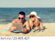 Купить «happy couple with tablet pc sunbathing on beach», фото № 23405421, снято 11 августа 2015 г. (c) Syda Productions / Фотобанк Лори