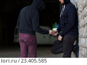 Купить «close up of addict buying dose from drug dealer», фото № 23405585, снято 9 июня 2016 г. (c) Syda Productions / Фотобанк Лори